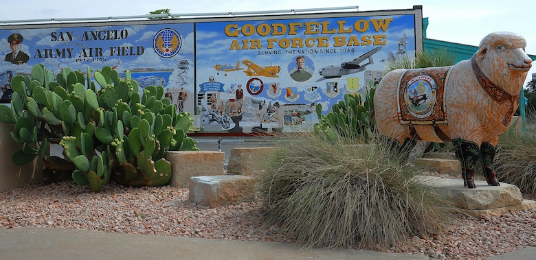The Military Mural, located in downtown San Angelo, depicts the heritage of Goodfellow Air Force Base, Texas, Sept. 9, 2015. The mural depicts the beginnings of the Air Force in San Angelo with the San Angelo Army Air Field with historical aircraft and buildings, like the AT-11 Bomb Trainer and the Sante Fe Orient Depot with crowds of GI's waiting for the train to San Angelo.  (U.S. Air Force photo by Airman Caelynn Ferguson/Released)