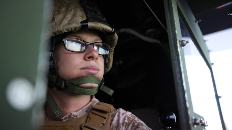Pfc. Stephanie L. Brown scans the digital desert horizon during a combat convoy simulator at Marine Corps Base Camp Lejeune, N.C., Sept. 9, 2015. Marines with 2nd Low Altitude Air Defense Battalion tested their combat skills and decision making as they maneuvered through a simulated desert, mimicking the possible scenarios they could encounter while in a real-life scenario. The training simulator allowed the Marines to efficiently train in a controlled environment without sacrificing safety or accuracy. Brown is a low altitude air defense gunner with 2nd LAAD based out of Marine Corps Air Station Cherry Point, N.C.