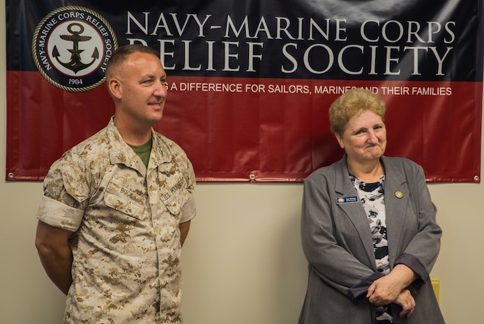 Col. Peter D. Buck congratulates Pam Mentzer during a celebration of her 20-year anniversary of employment with the Navy Marine Corps Relief Society aboard Marine Corps Air Station Beaufort Sept. 1. Her history of volunteer work with NMCRS goes back to 1980.  Mentzer is the director of NMCRS aboard the air station. Buck is the commanding officer of MCAS Beaufort.