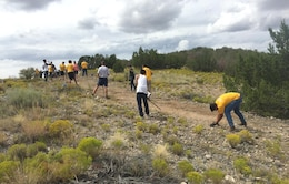 COCHITI LAKE, N.M. – Volunteers from the JROTC at Albuquerque's West Mesa High School work on a hiking trail at the project, Sept. 5, 2015.  The trail connects the Visitors Center with the swim beach.