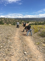 COCHITI LAKE, N.M. – Volunteers from West Mesa High School's JROTC work on a hiking trail at the project, Sept. 5, 2015.  The trail connects the Visitors Center with the swim beach.