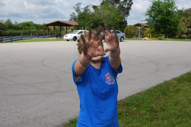 Volunteer has fun while planting at W.P. Franklin Lock Recreation Area