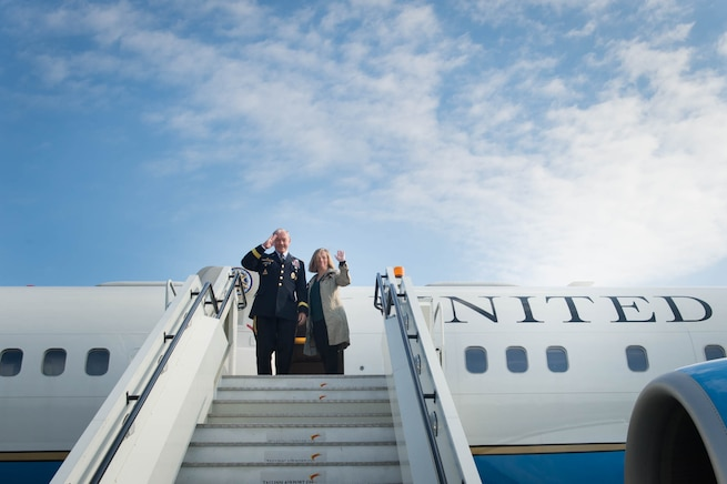 U.S. Army Gen. Martin E. Dempsey, chairman of the Joint Chiefs of Staff, and his wife, Deanie, gesture goodbye before leaving Estonia, Sept. 15, 2015. DoD photo by D. Myles Cullen