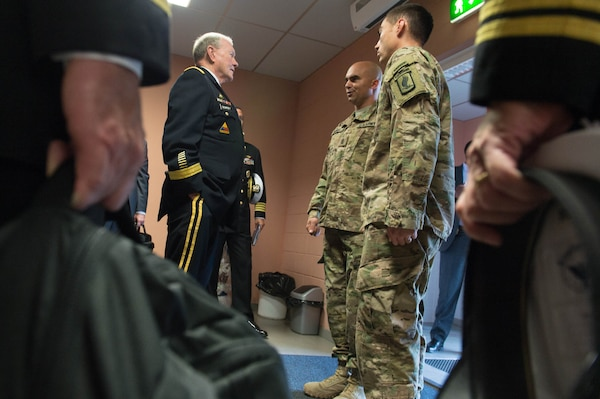 U.S. Army Gen. Martin E. Dempsey, chairman of the Joint Chiefs of Staff, left center, speaks with members of the U.S. Army's 173rd Airborne Brigade Combat Team at the Estonian 1st Brigade Headquarters in Tapa, Estonia, Sept. 15, 2015. DoD photo by D. Myles Cullen