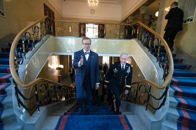 U.S. Army Gen. Martin E. Dempsey, right, chairman of the Joint Chiefs of Staff, walks with Estonian President Toomas Hendrik Ilves at the presidential palace in Tallinn, Estonia, Sept. 15, 2015. DoD photo by D. Myles Cullen