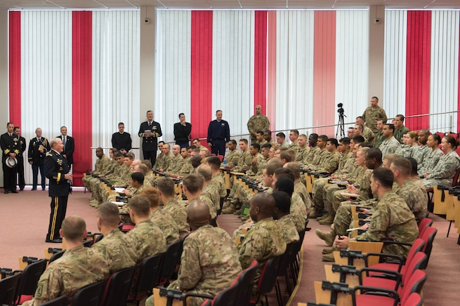 U.S. Army Gen. Martin E. Dempsey, chairman of the Joint Chiefs of Staff, talks with U.S. soldiers at the Estonian 1st Brigade Headquarters in Tapa, Estonia, Sept. 15, 2015. DoD photo by D. Myles Cullen