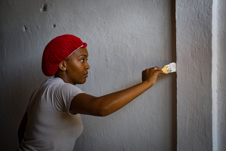 Tech. Sgt. Latrisha Skinner, Pacific Angel 15-2 optometrist, helps paint a health university building during a PACANGEL engineering project Sept 12, 2015, in Baucau, Timor-Leste. Efforts undertaken during Pacific Angel help multilateral militaries in the Pacific improve and build relationships across a wide spectrum of civic operations, which bolsters each nation's capacity to respond and support future humanitarian assistance and disaster relief operations. (U.S. Air Force photo by Staff Sgt. Alexander W. Riedel/Released)