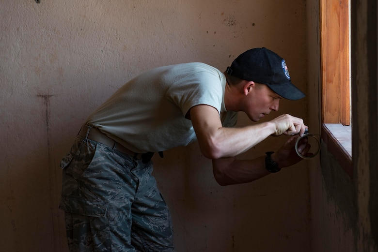 Airman 1st Class Benjamin Joyce, 35th Civil Engineer Squadron carpenter, tapes a window frame before a room is painted during a Pacific Angel 15-2 engineering project Sept 12, 2015, in Baucau, Timor-Leste. Efforts undertaken during Pacific Angel help multilateral militaries in the Pacific improve and build relationships across a wide spectrum of civic operations, which bolsters each nation's capacity to respond and support future humanitarian assistance and disaster relief operations. (U.S. Air Force photo by Staff Sgt. Alexander W. Riedel/Released)