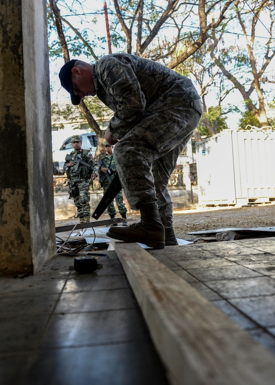 Tech. Sgt. Stephane Beck, Pacific Angel 15-2 structures technician, shortens a wood beam during a PACANGEL construction project Sept. 5, 2015, in Baucau, Timor-Leste. Efforts undertaken during Pacific Angel help multilateral militaries in the Pacific improve and build relationships across a wide spectrum of civic operations, which bolsters each nation's capacity to respond and support future humanitarian assistance and disaster relief operations. (U.S. Air Force photo by Staff Sgt. Alexander W. Riedel/Released)