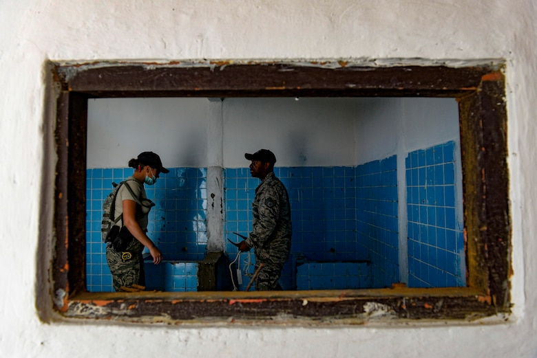 Senior Airman Blake Brooks, left, and Staff Sgt. Emenike Williams, both Pacific Angel 15-2 engineers, discuss work to be completed in a restroom of a medical university building, during a Pacific Angel engineering project Sept. 9, 2015, in Baucau, Timor-Leste. Efforts undertaken during Pacific Angel help multilateral militaries in the Pacific improve and build relationships across a wide spectrum of civic operations, which bolsters each nation's capacity to respond and support future humanitarian assistance and disaster relief operations. (U.S. Air Force photo by Staff Sgt. Alexander W. Riedel/Released)