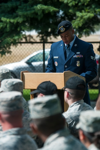 Senior Airman Darren Haroldgolden, 790th Missile Security Forces Squadron response force leader and 90th Missile Wing ceremonial guardsman, addresses the audience attending the 90th MW Honor Guard graduation ceremony Sept. 11, 2015, in the F.E. Warren Air Force Base, Wyo., cemetery. spoke of the need for professionalism like that shown by ceremonial guardsmen in light of the reminder on Sept. 11 of the grievous attacks against the U.S. in 2001. (U.S. Air Force photo by Senior Airman Jason Wiese)