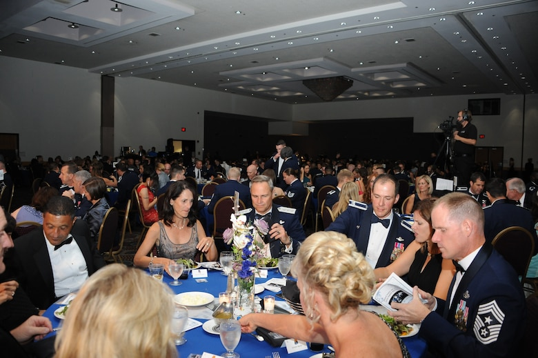 U.S. Airmen from Davis-Monthan Air Force Base dine at the Air Force Ball at the Tucson Convention Center, in Tucson, Ariz., Sept. 12, 2015. Attendees dined while emcees performed musical skits that rehashed D-Ms history and influence beginning in 1925 as an airfield, to 1941 when it was converted into an Army Air Base. (U.S. Air Force photo by Airman 1st Class Ashley N. Steffen/Released)