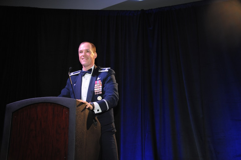 U.S. Air Force Col. James P. Meger, 355th Fighter Wing commander, gives a speech during the Air Force Ball at the Tucson Convention Center, in Tucson, Ariz., Sept. 12, 2015. As the event's host, Meger spoke and participated in a musical skit featuring the history of Davis-Monthan Air Force Base. (U.S. Air Force photo by Airman 1st Class Ashley N. Steffen/Released)