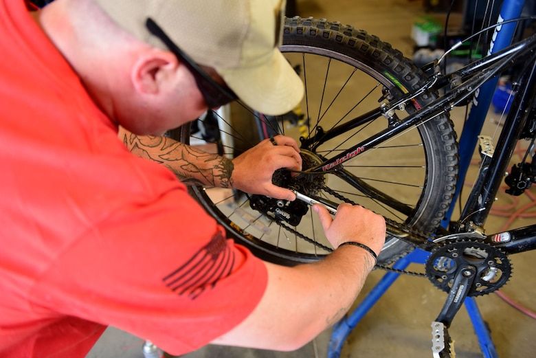 TJ Binder, 28th Force Support Squadron outdoor recreation technician, repairs a mountain bike at the Outdoor Recreation Center at Ellsworth Air Force Base, S.D., Sept. 11, 2015. Mountain bikes are one of many items that Airmen can rent from the facility. (U.S. Air Force photo by Airman 1st Class James L. Miller/Released)