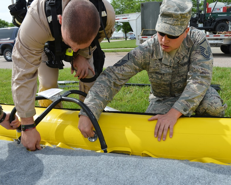 Master Sgt. Robert Bogle, 155th Fire Department, helps inflate a rescue raat the 155th Air Refueling Wing Domestic Operations training session, showcasing the Nebraska Air National Guard's capabilities in emergency management to Nebraska Civil leaders June 5 at the Nebraska National Guard air base, Lincoln, Neb.