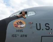 Mariah Harm, a Stapleton, Neb., native and senior at Stapleton High School, unveils her artwork on the nose of a KC-135R Stratotanker at the 155th Air Refueling Wing, Nebraska Air National Guard Base Aug. 8, in Lincoln, Neb.