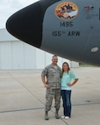 Mariah Harm, a Stapleton, Neb., native and senior at Stapleton High School, stands with her father, Senior Master Sgt. Toby Harm, after unveiling her artwork on the nose of a KC-135R Stratotanker at the 155th Air Refueling Wing, Nebraska Air National Guard Base Aug. 8, in Lincoln, Neb.