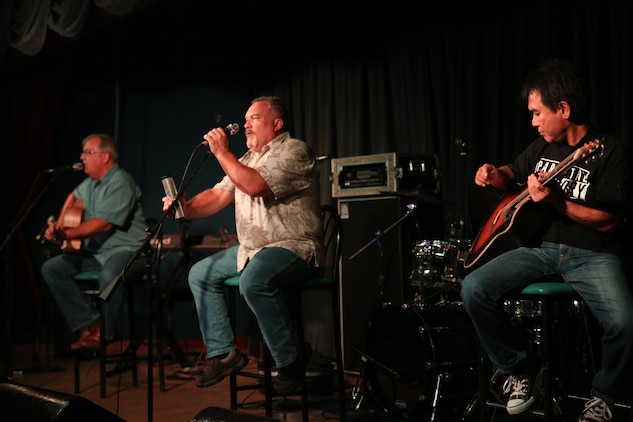 Full Circle, a band who plays primarily for service members, prepares to play for the service members aboard Marin Corps Air Station Iwakuni, Japan during the Summer Music Festival August 29, 2015. Full Circle plays primarily Americana music in hopes of giving the service members stationed overseas a little taste of home.