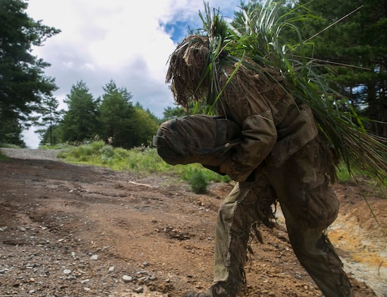 Navy Petty Officer 3rd Class Deven Lewis runs across a clearing while participating in stalking drills during Forest Light 16-1 at Camp Imazu, Takashima, Japan, Sept. 10, 2015. The Marines sat up on a high embankment, trying to catch Lewis stalking the target with binoculars. Forest Light is a semiannual, bilateral exercise consisting of a command post exercise and multiple field training events, conducted by elements of III Marine Expeditionary Force and the JGSDF. Lewis from Idaho Falls, Idaho, is a hospital corpsman with 1st Battalion, 2nd Marine Regiment currently assigned to 4th Marine Regiment, 3rd Marine Division, III Marine Expeditionary Force.