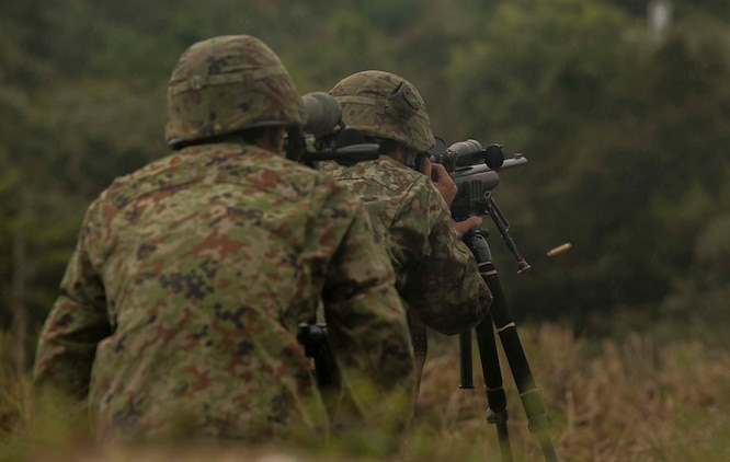 Japanese Ground Self-Defense Force Sgt. Akito Yagi fires his sniper rifle at the 600 meter line during forest light 16-1 at Camp Imazu, Takashima, Japan, Sept. 11, 2015. The JGSDF fired their rifles with precision accuracy at the 400 and 600-meter firing line at man-sized targets. Forest Light is a semiannual, bilateral exercise consisting of a command post exercise and multiple field training events, conducted by elements of III Marine Expeditionary Force and the JGSDF. Yagi is a sniper with 50th Infantry Regiment, 14th Brigade.