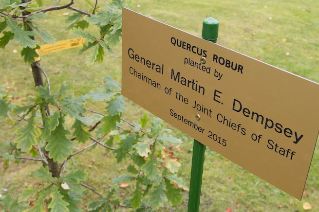 A sign marks the spot where U.S. Army Gen. Martin E. Dempsey, chairman of the Joint Chiefs of Staff, plants an oak tree at the Estonian Defense Forces Headquarters in Tallinn, Estonia, Sept. 14, 2015. The tree symbolizes a long and growing friendship between the two nations' militaries. DoD photo by D. Myles Cullen