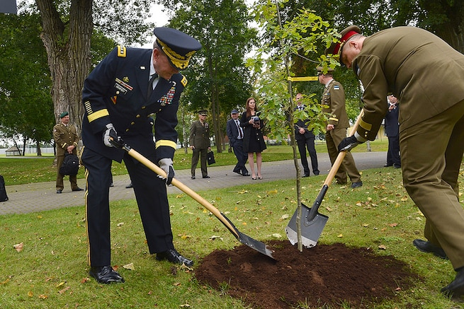 U.S. Army Gen. Martin E. Dempsey, chairman of the Joint Chiefs of Staff, and Estonian Lt. Gen. Riho Terras, commander of Estonian Defense Forces, plant an oak tree at the Estonian Defense Forces Headquarters in Tallinn, Estonia, Sept. 14, 2015. The tree symbolizes a long and growing friendship between the two nations' militaries. DoD photo by D. Myles Cullen