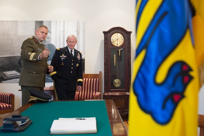 Estonian Lt. Gen. Riho Terras, commander of Estonian Defense Forces, asks U.S. Army Gen. Martin E. Dempsey, right, chairman of the Joint Chiefs of Staff, to sign a guest book at the Estonian Defense Forces Headquarters in Tallinn, Estonia, Sept. 14, 2015. DoD photo by D. Myles Cullen