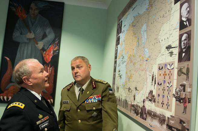 Estonian Lt. Gen. Riho Terras, commander of Estonian Defense Forces, and U.S. Army Gen. Martin E. Dempsey, chairman of the Joint Chiefs of Staff, review a historic map of Estonia at the Estonian Defense Forces Headquarters in Tallinn, Estonia, Sept. 14, 2015. (DoD photo by D. Myles Cullen