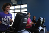 Members of the New You Fitness Class Lisa Medrano, civilian employee with the Command Investigative Division (left), Kathy Mead, spouse of Lt Col. Mead (center), and Jesenia Young, civilian employee at Irwin Army Community Hospital (right), start warmups for class.