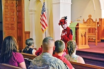 Marla Matkin, as Libbie Custer, speaks to audience members during her Aug. 24 performance.  She has been performing as Mrs. Custer for more than 20 years.
