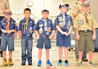 Members from Pack 260 line up to show potential new members and their families the different uniforms while explaining the levels of Cub Scouts.