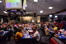 Soldiers, families and civilians gather to play the last game of Monster Jackpot Bingo August 29 at Rally Point. The jackpot prize was $25,000, but participants had to get a coverall bingo within 50 numbers being called. The consolation prize of $5,000 was given to Sicilee Lansbury, spouse of a Fort Riley Soldier.