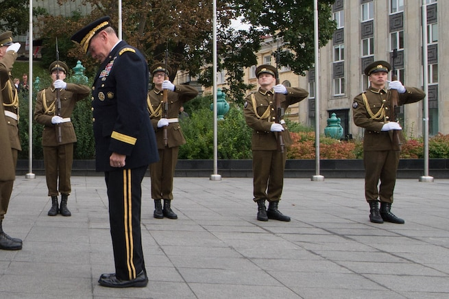 U.S. Army Gen. Martin E. Dempsey, chairman of the Joint Chiefs of Staff, bows his head in a moment of silence at the War of Independence Victory Column in Tallinn, Estonia, Sept. 14, 2015. The site was opened on June 23, 2009 as a memorial for those who fell during the Estonian War of Independence. DoD photo by D. Myles Cullen