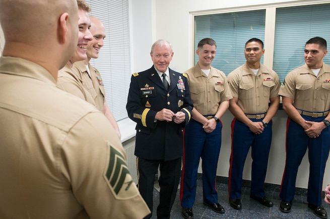 U.S. Army Gen Martin Dempsey, chairman of the Joint Chiefs of Staff, meets with Marines who provide security at the U.S. Embassy in Tallinn, Estonia, Sept 14, 2015. DoD photo by D. Myles Cullen