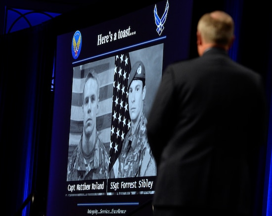 Air Force Chief of Staff Gen. Mark A. Welsh III honors two fallen special tactics Airmen during his Air Force Update address at the Air Force Association's Air and Space Conference and Technology Exposition Sept. 15, 2015, in Washington, D.C.  Capt. Matthew D. Roland and Staff Sgt. Forrest B. Sibley were killed Aug. 26, 2015, in Afghanistan. (U.S. Air Force photo/Scott M. Ash)