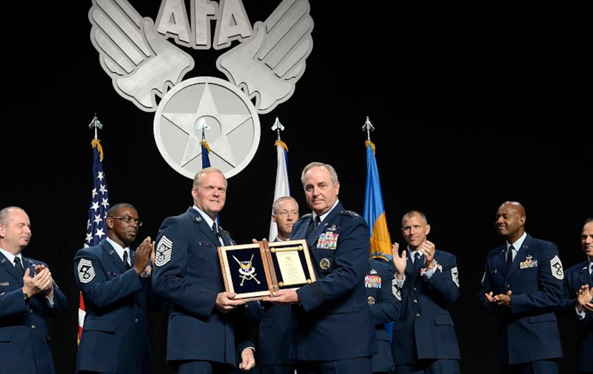 "Chief Master Sgt. of the Air Force James A. Cody thanks Air Force Chief of Staff Gen. Mark A. Welsh III for his exceptional service by presenting him with an invitation to an Order of the Sword ceremony following Cody's ""Enlisted Force Update"" at Air Force Association's Air and Space Conference and Technology Exposition Sept. 16, 2015, in Washington, D.C.  (U.S. Air Force photo/Scott M. Ash)"