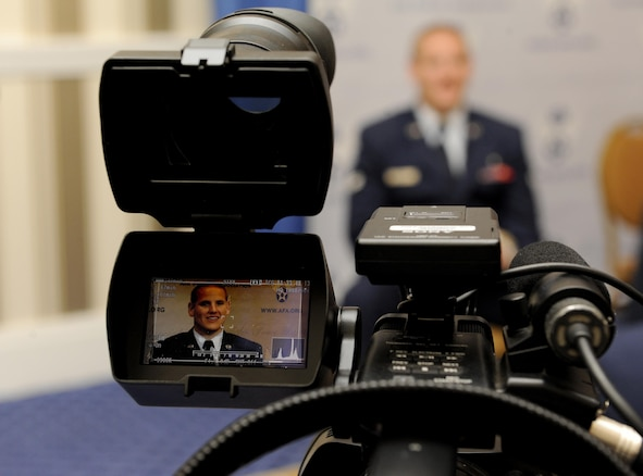 Airman 1st Class Spencer Stone answers question during an interview at the Air Force Association's Air and Space Conference and Technology Exposition in Washington, D.C., Sept. 16, 2015. The conference brings together Air Force leadership, industry experts, academia and current aerospace specialists from around the world to discuss the issues and challenges facing America and the aerospace community today.  (U.S. Air Force photo/Staff Sgt. Whitney Stanfield)
