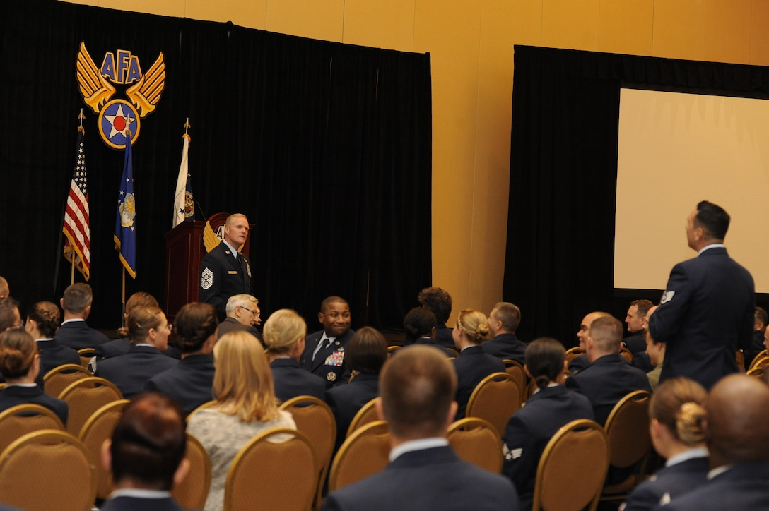 Staff Sgt Jireh Aki, a installation antiterrorism officer at Joint Base Andrews, Md., asks Chief Master Sgt. of the Air Force James A. Cody a question during the Air Force Association Air and Space Conference and Technology Exposition in Washington, D.C., Sept. 16, 2015. Cody said each Air Force generation gets better with technology and education, but if they do not, then the leaders have failed them. (Air Force photo/Staff Sgt. Whitney Stanfield)