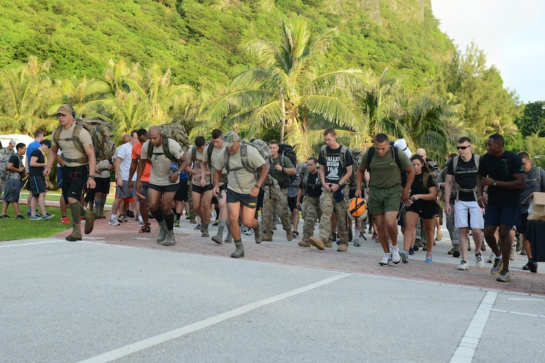 Participants start the race during the POW/MIA memorial ruck march Sept. 16, 2015, at Tarague Beach on Andersen Air Force Base, Guam. Approximately 100 participants attended the ruck march to honor prisoners of war and service members missing in action. (U.S. Air Force photo by Airman 1st Class Arielle Vasquez/Released)