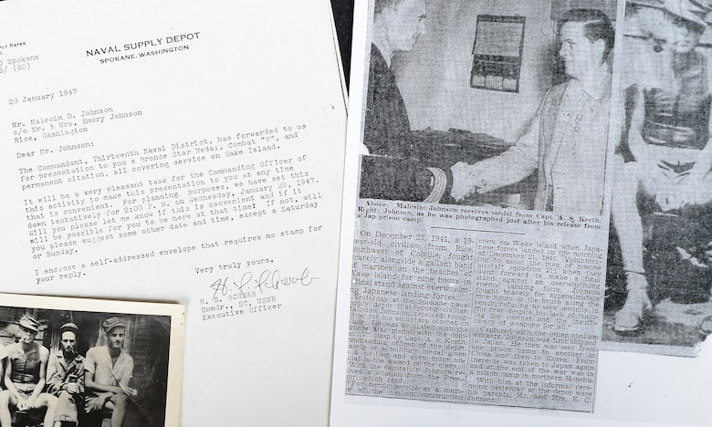 A photo of Malcolm Johnson upon his release from a Japanese internment camp, a notification of being awarded a Bronze Star Medal, and a news article are shown at Davis-Monthan Air Force Base, Ariz., Aug. 26, 2015. Some of Johnson's memorabilia will be on display at the Pima Air and Space Museum in Tucson, Ariz., Sept. 18, 2015, in observance of POW/MIA day. (U.S. Air Force photo by Airman 1st Class Mya M. Crosby/Released)