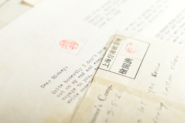 Letters sent between Malcolm Johnson, World War II veteran and former prisoner of war, and his family are shown at Davis-Monthan Air Force Base, Ariz., Aug. 26, 2015. Johnson was able to write his first letter home nearly five months after he was captured by Japanese forces. (U.S. Air Force photo by Airman 1st Mya M. Crosby/Released)