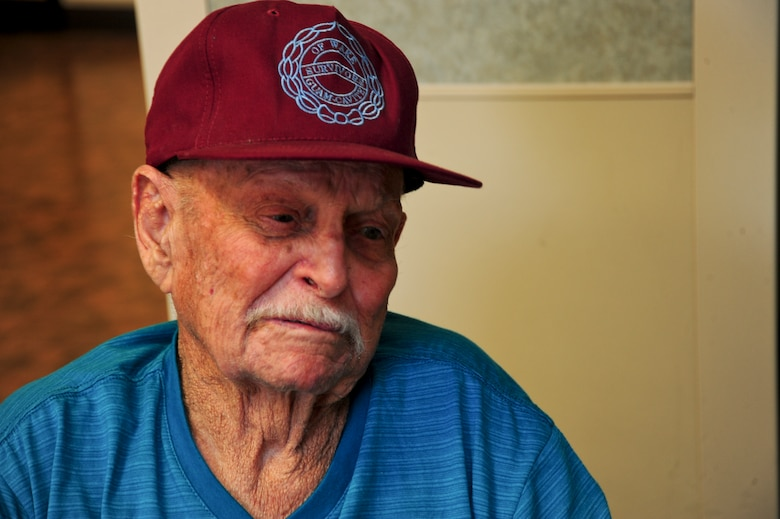 Malcolm Johnson, World War II veteran and former prisoner of war, tells his story at the Tucson Veterans Center in Tucson, Ariz., Aug. 18, 2015. Johnson was a civilian contractor when he was captured in December 1941. Nearly five years after being captured, Johnson was awarded the Bronze Star Medal with Valor in 1947. (U.S. Air Force photo by Senior Airman Chris Massey/Released)