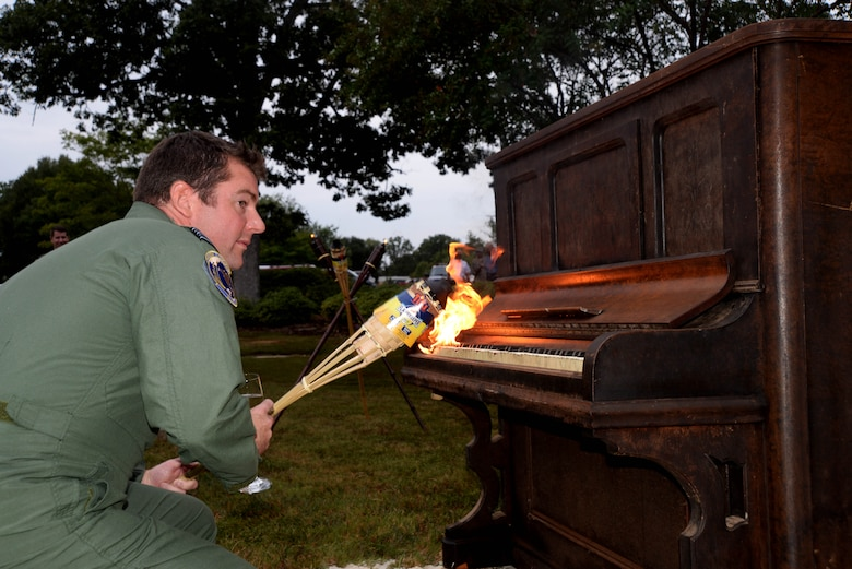 Royal Air Force Lt. Col. James Radley, an Air Command and Staff College student, sets a piano ablaze during the celebration of the 75th anniversary of the Battle of Britain Sept. 11, 2015, at Maxwell Air Force Base, Alabama. American Airmen, international partners and Royal Air Force officers participated in the piano burning to commemorate the Battle of Britain, an air campaign conducted by the German Luftwaffe against the United Kingdom in 1940. The Battle of Britain was the first victory over the Germans and served as a turning point in the war. (U.S. Air Force photo by Airman 1st Class Alexa Culbert/Cleared)