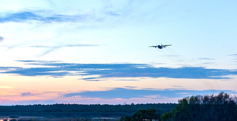 A C-130 Hercules Aircraft from the 757th Airlift Squadron, an Air Force Reserve unit from Youngstown, OH, conducts a dry run for the mosquito aerial spray over Joint Base Charleston - Weapons Station in Charleston, South Carolina, Sept. 11, 2015. Aerial spray flight proficiency training was also accomplished while providing a beneficial reduction in mosquito populations affecting the health and welfare of the people at Joint Base Charleston. (U.S. Air Force photo/Airman 1st Class Thomas T. Charlton)