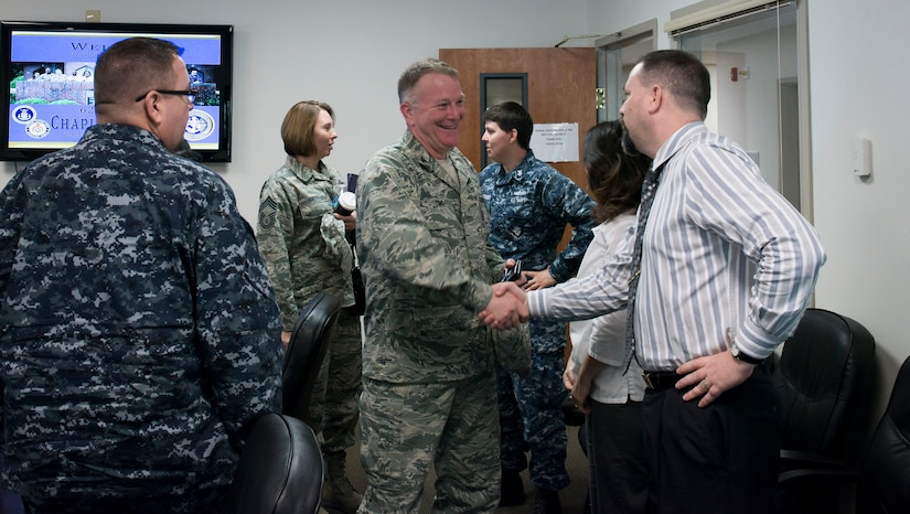Chaplain (Col.) James Tims, Air Mobility Command chaplain, meets with the Air Base chapel staff Sept. 14, 2015, at the Air Base chapel on Joint Base Charleston – Air Base, S.C. Tims was visiting JB Charleston to meet with the Air Base and Weapons Station chaplains and staff to see the mission firsthand. (U.S. Air Force photo/Airman 1st Class Clayton Cupit)