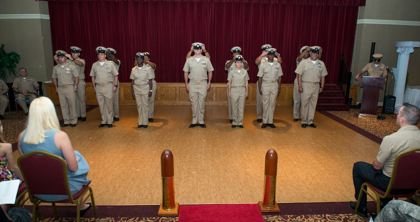 Joint Base Charleston's newest Chief Petty Officer selects are hatted by their sponsors Sept. 16, 2015, at the Redbank Club on JB Charleston – Weapons Station, S.C. CPO's serve a dual role as both technical experts and as leaders. The new selects (Left to right) are EMC(SW/AW) Thomas Byers, Navy Operation Support Center, LSC(SW/AW) Christopher Byrd, NOSC, YNC(SW/AW) Ashley Cooper, Navy Consolidated Brig Charleston, HMC Marchae Howard, NOSC, FCC(SW) William McElroy, NAVCONBRIG Charleston, YNC(EXW) Jayna Sampson, NOSC, MNC(SW) David Toyloy, Navy Munitions Command Unit Charleston and DCC(EXW) Paul Wilkins, NOSC. (U.S. Air Force photo/Airman 1st Class Clayton Cupit)