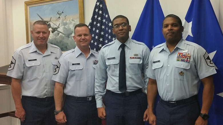 Chief Master Sgt. Bo Stout, U.S. Air Force Headquarters paralegal career field manager, Chief Master Sgt. Robert Bedell, 30th Space Wing command chief, Airman 1st Class Cardell Morgan, 30th SW Judge Advocate civil law paralegal and Chief Master Sgt. Larry Tolliver, senior paralegal manager to the Judge Advocate General, pose for a photo, Sept. 8, 2015, Washington, D.C. Morgan was recently selected to attend a trip to Capitol Hill with Col. Christopher Moss, 30th Space Wing commander and Chief Master Sgt. Robert Bedell, 30th SW command chief, to meet with Congressional representatives for the Central Coast. (courtesy photo)