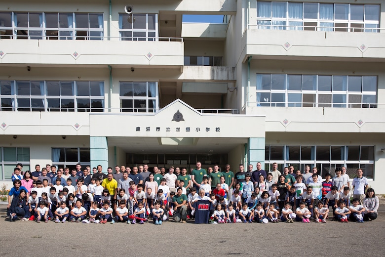 Sixty four students from the Kasono Elementary School and Airmen and civilians from the 374th Civil Engineer Squadron pose for a group photo after the appreciation ceremony at Kasono El-ementary School, Kanuma City, Tochigi Prefecture, Sept. 15, 2015. Sixty Airmen and civilians from the 374th CES volunteered to help at sites in the Kasono area in support of floods and landslides caused by the heavy rainfall associated with the post-tropical remnant of Tropical Storm Etau, which stalled over eastern Japan, dumping up to 17 inches of rain in 24 hours, from Sept. 10 to Sept. 11. (U.S. Air Force photo by Osakabe Yasuo/Released)