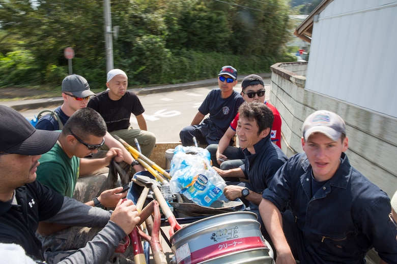 Volunteers from the 374th Civil Engineer Squadron ride in the back of a pickup truck in support of landslide sites at Kanuma City, Tochigi Prefecture, Japan, Sept. 15, 2015. Sixty Airmen and civilians from the 374th CES volunteered to help at sites in the Kasono area in support of floods and landslides caused by the heavy rainfall associated with the post-tropical remnant of Tropical Storm Etau, which stalled over eastern Japan, dumping up to 17 inches of rain in 24 hours, from Sept. 10 to Sept. 11. (U.S. Air Force photo by Osakabe Yasuo/Released)