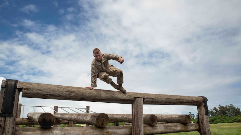 Pfc. Carlton Fyfee, a rifleman with Bravo Company, 1st Battalion, 3rd Marine Regiment and Kilgore, Texas native, hops over a log while running through the obstacle course at Boondocker Training Area aboard Marine Corps Base Hawaii, Sept. 15, 2015. Marines from Bravo Co. 1st Bn., 3rd Marines conducted sustainment training to ensure they keep their combat mindset sharp and intact before embarking on their upcoming Unit Deployment Program. Training like this supports the mission of Marine Corps Base Hawaii by enhancing and sustaining combat readiness.